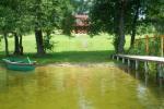 Sodyba su pirtimi ant pačio Trikojo ežero kranto