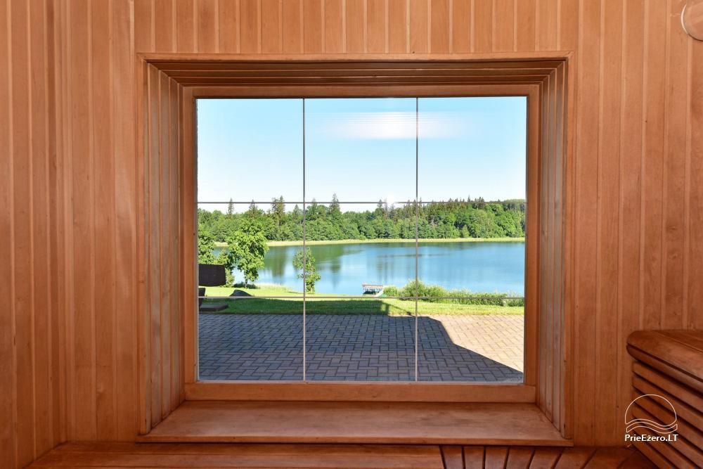 Pirties namas su langu į ežerą: pirtis, priepirtis, terasa, miegamieji