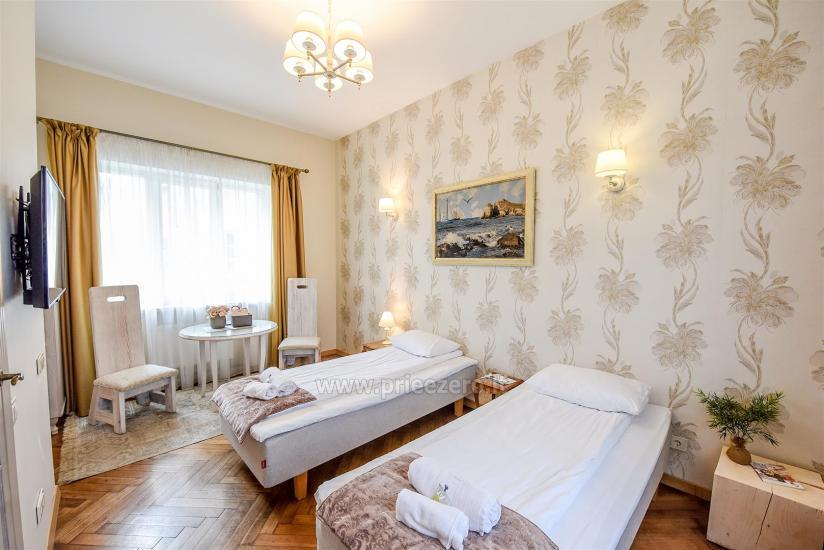 KUBU svečių namai Klaipėdoje. Moderniai įrengti apartamentai, yra sukūrinė vonia, pirtis - 14