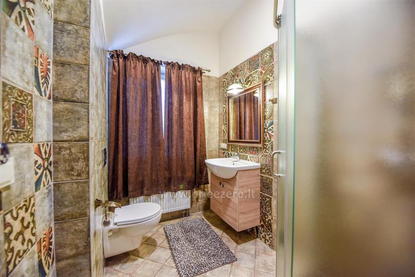 KUBU svečių namai Klaipėdoje. Moderniai įrengti apartamentai, yra sukūrinė vonia, pirtis - 15