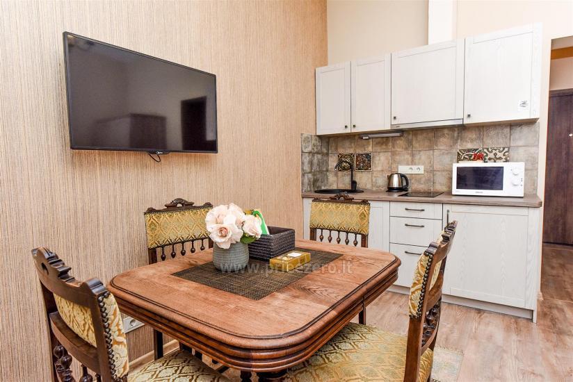 KUBU svečių namai Klaipėdoje. Moderniai įrengti apartamentai, yra sukūrinė vonia, pirtis - 17