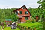13 vietų namas: svetainė-valgomasis, virtuvė, 5 miegamieji, terasa, balkonai, dušas, WC - 1